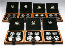 Sale 9175 - Lot 64 - Set of Seven XXI Montreal Olympics Silver $10 & $5 Commemorative Coins Boxed