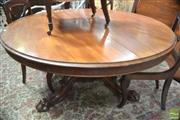 Sale 8317 - Lot 1093 - Victorian Mahogany Supper Table, the round tilt-top on turned reeded pedestal, raised on paw feet (split to top, lifting veneer to p...