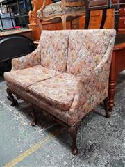 Sale 8814 - Lot 1020 - Georgian Style Carved Mahogany Sofa, upholstered in autumnal leaves patterned fabric, on shell carved cabriole legs