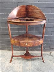 Sale 9048 - Lot 1038 - George III Mahogany Corner Washstand, with high curved back, round receptacle, above a shelf with drawer & stretcher base (h:107cm)