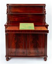 Sale 9044J - Lot 62 - An unusual rare George IV mahogany cabinet with a secret secretaire C: 1825. The double shelf back and top on a freize with a concea...