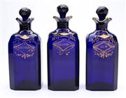 Sale 8528A - Lot 13 - Three Georgian bristol blue glass spirit decanters, gilded, with stars and, rum, brandy and Hollands, total H 20cm