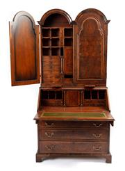 Sale 9044J - Lot 30 - A Queen Anne reproduction 2 part burr walnut secretaire bookcase by English furniture makers Caeden & Mayhew, C: 20th century. The...