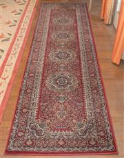 Sale 8368A - Lot 4 - A decorative machine made runner, burgundy ground with four central medallions, 300 x 80cm