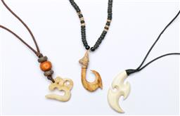 Sale 9164 - Lot 511 - Three carved pendant necklaces to include Nepalese horn