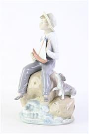 Sale 8815 - Lot 14 - Lladro Figure of a Seated Boy and a Dog