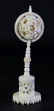 Sale 8989 - Lot 31 - An Early/Mid 20th Century Intricately Carved Ivory Puzzleball On Stand H: 20cm
