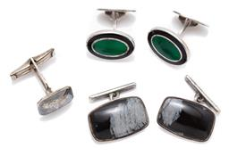 Sale 9194 - Lot 545 - TWO PAIRS OF SILVER ENAMELLED AND STONE SET CUFFLINKS; oval guilloche tops set with black and green enamel to folding backs with Ita...