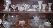 Sale 8515A - Lot 34 - Two shelf lots of glasswares including cake plates, trifle bowls, dishes, stemware etc