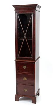 Sale 9044J - Lot 75 - An English antique mahogany rare narrow bookcase on chest C: 1830. The quarrelled glazed door book sectiion fitted with adjustable s...
