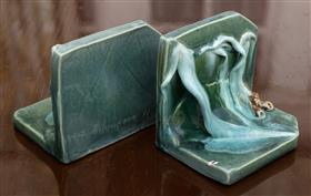 Sale 9195H - Lot 78 - A pair of early Australian gumnut leaf ceramic bookends by Violet Champion 1937