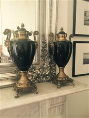 Sale 8298 - Lot 11 - A Pair of French Bronze and black enamel lidded urns with scroll handles.