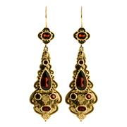 Sale 8651 - Lot 387 - A PAIR OF VICTORIAN STYLE 9CT GOLD GEMSET DROP EARRINGS; set with mixed cut red garnets, length 62mm.