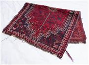 Sale 8891H - Lot 74 - A Persian handmade woollen carpet, on a red ground with blue border 130cm x 87cm