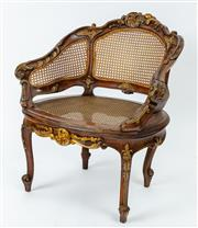 Sale 9044J - Lot 28 - A lovely small antique walnut parcel giltwood carved bergere. The carved Roccoco chair back upholstered in 3 hand caned panels to a ...
