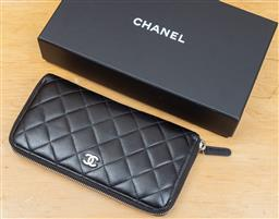 Sale 9165H - Lot 82 - A Black quilted Chanel wallet in original pouch and box, Height11.5 x Length 20 x Width 20 cm