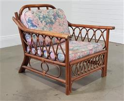 Sale 9255 - Lot 1051 - Cane armchair together with a glass top cane based coffee table (chair h:77 w:74 d:84cm)
