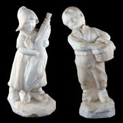 Sale 8000 - Lot 358 - A pair of carved alabaster figures of Dutch boy and girl, the girl figure signed to back.