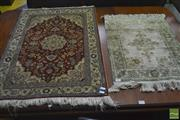 Sale 8255 - Lot 1083 - Small Persian Style Silk Carpets, one cream & russet tones, the other green & cream (2)