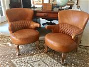 Sale 8530A - Lot 38 - A pair of tan leather Deco style diamond stitch back armchairs on cabriole legs, with brass stud details, H 84 x W 62 x D 68cm