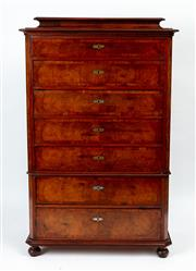 Sale 9044J - Lot 65 - An antique French figured walnut Semanier C: 1880. The deep stepped cornice above 7 cross banded drawers each with brass escutcheons...