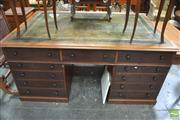 Sale 8291 - Lot 1084 - Late Victorian Mahogany Partners Desk, with tooled olive leather top, each side fitted with eleven drawers