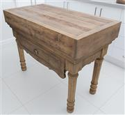 Sale 8530A - Lot 225 - A bleached pine butchers block with carved drawer and legs, and metal handle, W 120 x D 60 x H 89cm