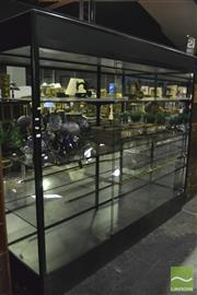Sale 8380 - Lot 1015 - Large Black Light Up Display Cabinet with Shelving