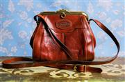 Sale 8577 - Lot 103 - A vintage brown leather Oroton crossbody handbag with gold frame and hardware featuring leather embossed logo on the front, H 20 x W...