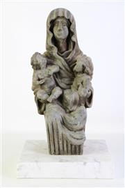 Sale 8905S - Lot 625 - A rustic timber figure of a nun holding two children on a marble base. Height 46