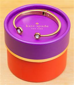 Sale 9165H - Lot 106 - Kate Spade hinged bangle in pouch and box, Width 6.5cm