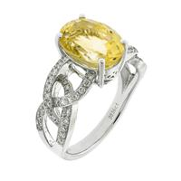 Sale 8221A - Lot 76 - 18ct White Gold Diamond and Gem Stone Ring; centering an oval cut citrine to looping shoulders, set with round brilliant cut diamond...