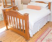 Sale 8380A - Lot 56 - A maple federation double bed with bedding and bolsters, frame W 142cm, damage to post