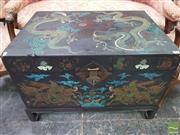 Sale 8444 - Lot 1026 - Chinese Black Lacquered Wedding Chest on Stand, painted with swirling dragons chasing a pearl, children riding lions & lotus flowers