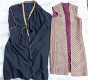 Sale 8800 - Lot 238 - Two Eastern gowns one claret with gilt thread open long vest, the other black with gilt and sequins