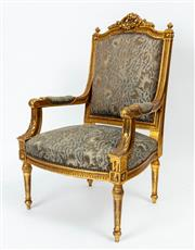 Sale 9044J - Lot 67 - A French carved giltwood Armchair C: 1890. The shaped top rail with a pierced carved crest flanked by finials on a reed and bead upr...