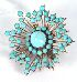 Sale 3682 - Lot 631 - A 14CT GOLD STARBURST BROOCH SET WITH TURQUOISE;