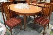 Sale 8528 - Lot 1036 - Teak Table and Set of Six Chairs