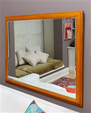 Sale 8741A - Lot 17 - A bevelled edge mirror in a maple frame 103cm x 133cm