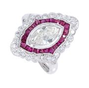 Sale 8879 - Lot 375 - A DECO STYLE RUBY AND DIAMOND RING; platinum set with a marquise brilliant cut diamond of approx. 0.70ct to a surround of mixed cut...