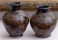 Sale 8934H - Lot 22 - A pair of studio pottery baluster vases with mottled blue and brown glaze with three finger paw mark stamp, Height 9.5cm