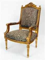 Sale 9044J - Lot 66 - A French carved giltwood Armchair C: 1890, matching the next lot. The shaped top rail with a pierced carved crest flanked by finials...