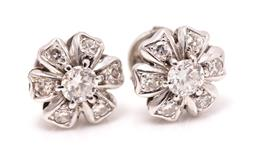 Sale 9260H - Lot 357 - A pair of 18ct wite gold diamond floral cluster earrings; each centring a round brilliant cut diamond of approx. 0.32ct to surround...