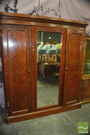 Sale 8428 - Lot 1066 - Victorian Satinwood Wardrobe, with centre mirror & two timber panel doors, enclosing slides & drawers, the cantered corners with car...