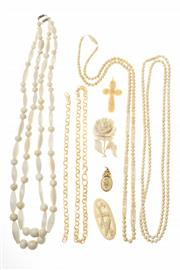 Sale 8502 - Lot 320 - IVORY AND BONE NECKLACES AND BROOCHES; 4 necklaces (one broken), 2 brooches, cruciform pendant and a 9ct gold set pendant.