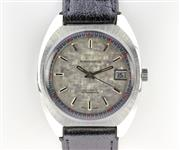 Sale 8644W - Lot 18 - SANDOZ OLTRASHOCK AUTOMATIC WRISTWATCH; cushion form stainless steel case, round textured dial, applied markers, center seconds, dat...