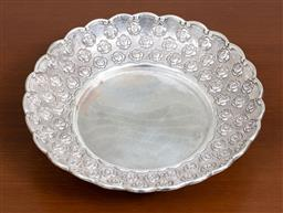 Sale 9140H - Lot 75 - A 925 silver tri-footed raised dish with scalloped edge and rose bud border, Diameter 20.5cm, Weight 261g