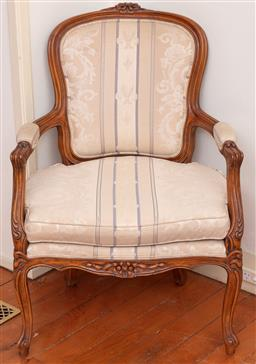 Sale 9190H - Lot 137 - A vintage Louis XVI Bergere, the beech carved frame upholstered in blue stripe and 2 tone gold foliate and fleur de Lise. The chair...