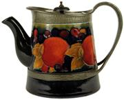 Sale 8057 - Lot 79 - Moorcroft Pomegranate Pewter Bound Teapot