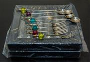 Sale 8310A - Lot 169 - Two boxes of fancy handled dessert spoons, with four forks